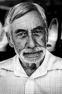 grayscale photo of man wearing button-up top