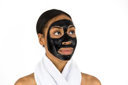 woman in black facial mask