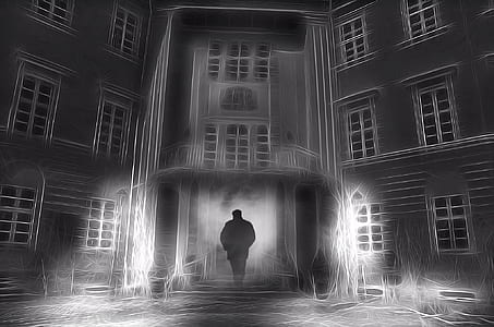 man silhouette near house