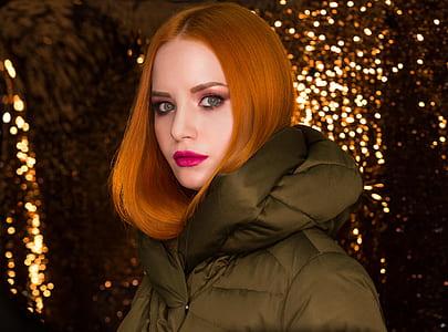 woman wearing puffer jacket with bokeh background