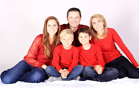 family wearing red long-sleeved shirts