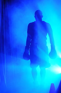 silhouette of boxer surrounded with mist