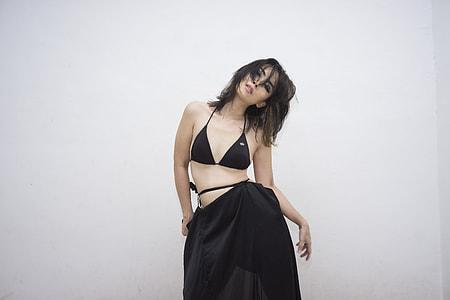 woman wearing black halterneck bikini top
