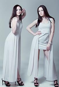 woman wearing white scoop-neck tank high-low dress