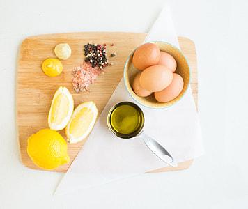 ingredients for homemade mayo, eggs, salt, pepper, mustard, lemon, olive oil