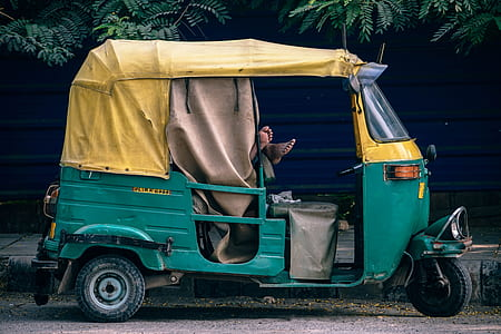 green and yellow auto rickshaw