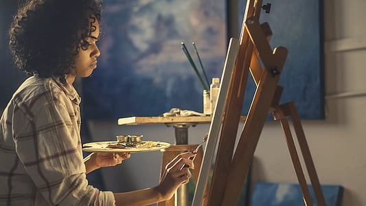 woman doing painting