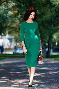shallow focus photography of woman wearing green 3/4-sleeved dress