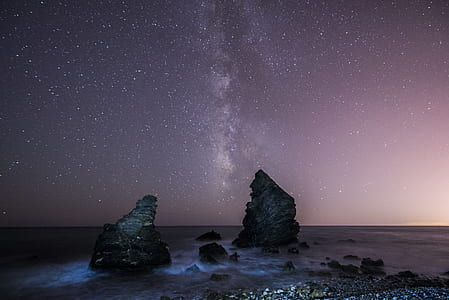 rocks on field under starry sky