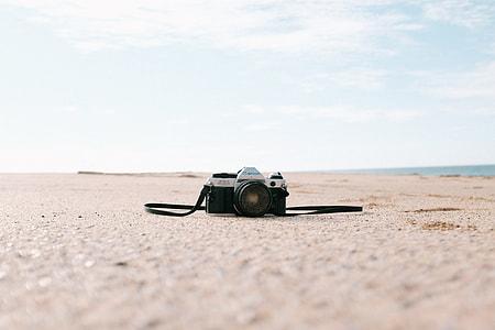 film camera on sand