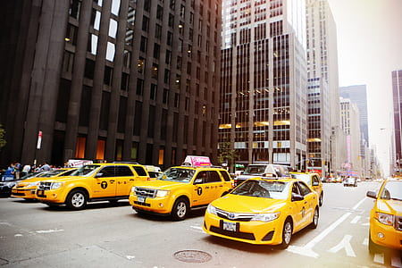 yellow taxi cars on road