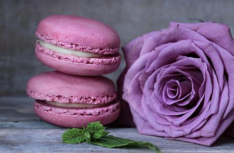purple rose beside two pink macaroons