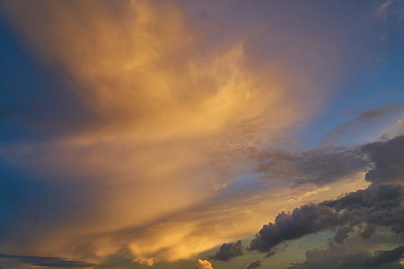 orange and dark clouds on sky