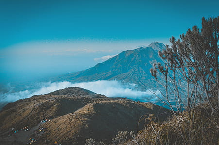 Landscape Photography of Mountain Surrounded by Sea of Clouds