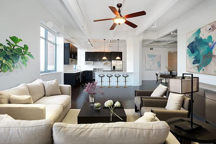white fabric sofa furniture set near glass window taken on lighted room