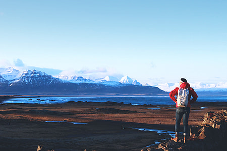 A hiker views the stunning mountains and vistas in Iceland