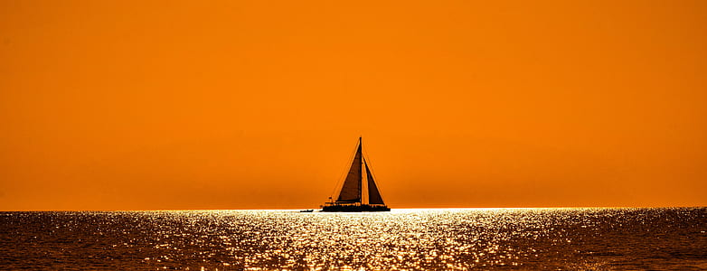 silhouette of sailing boat in the sea