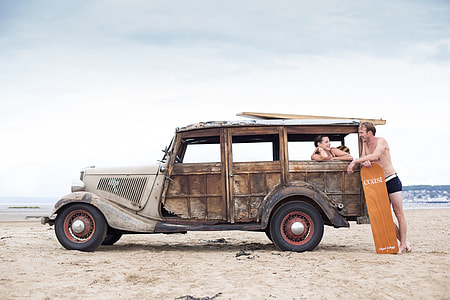 man talking to woman inside brown vehicle