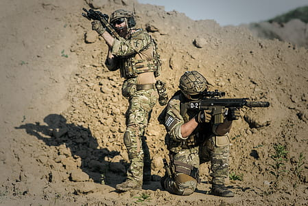 Two Men in Army Uniforms With Guns