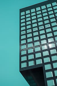 black and teal building illustration