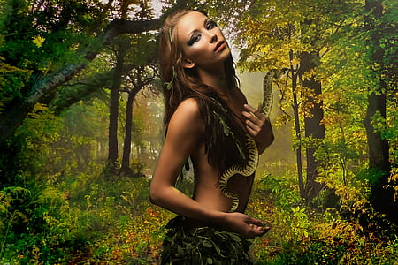 woman wearing green leaf clothes in forest