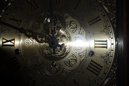 round silver-colored clock reading at 11:48