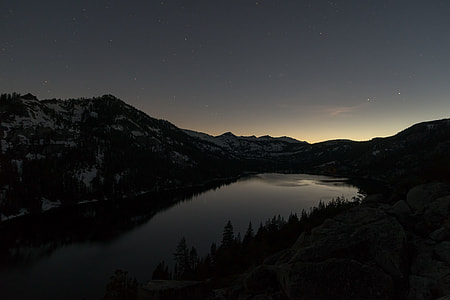 alps with lake during nighttime