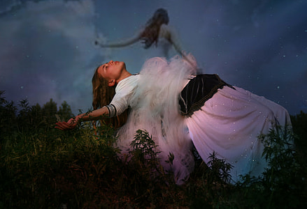 woman in white dress floating on air