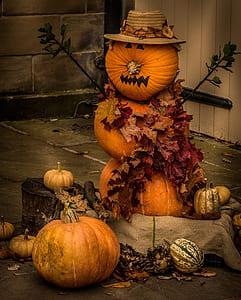 Pumpkin Snowman wearing hat