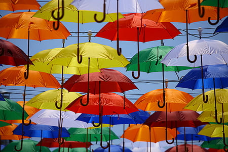 multicolored umbrellas flying on sky during daytime