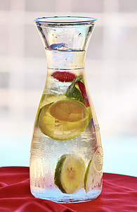 clear glass jar with water and lemon