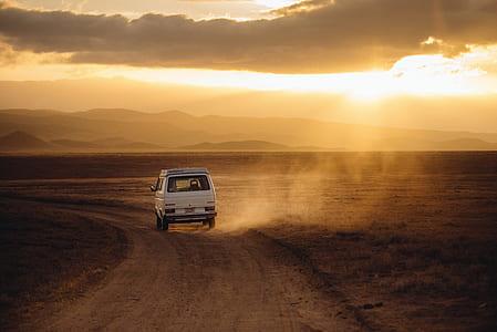 car driving through sand road