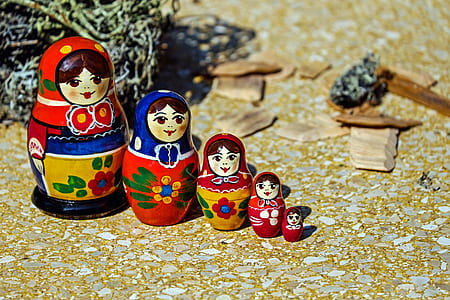 red, blue, and white floral matryoshka doll