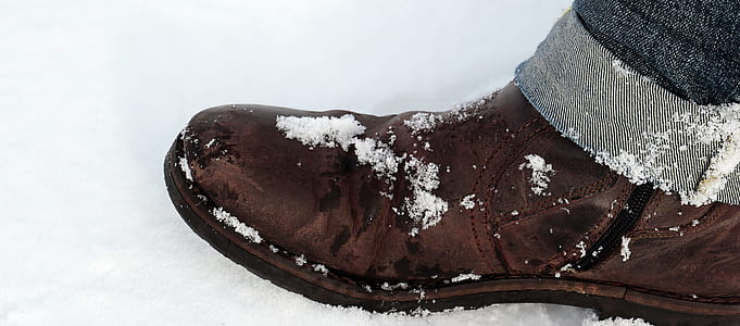 brown boot covered with snow