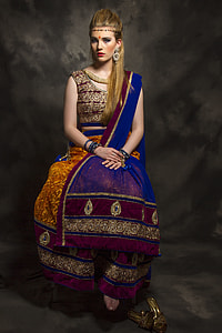 woman in multicolored sari dress sitting on chair