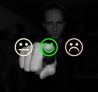person touching emoji