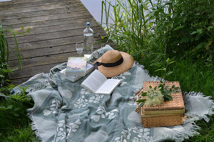 book near brown wicker picnic basket