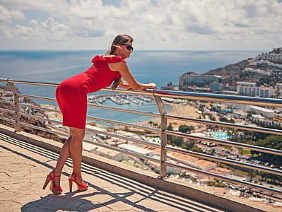 woman kneeling toward silver railings