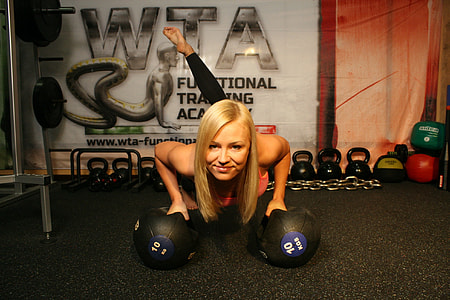 woman exercising using bosu ball