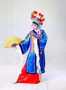 woman wearing blue, white, and red traditional coat