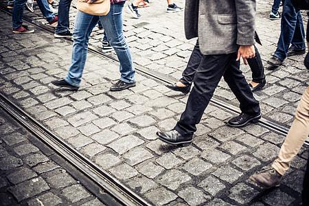 Crowd of People Crossing an Old Prague Road