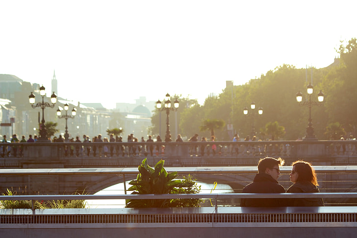 man and woman staring at each other near concrete bridge during daytime