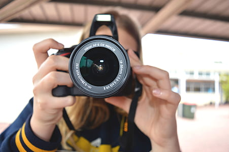 Person Holding Black Dslr Camera