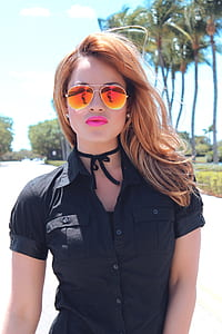 woman wearing black button-up shirt with sunglasses