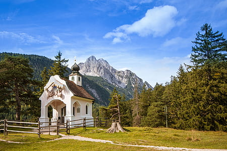 photo of chapel with mountains background