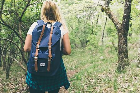 woman walking inside a forest