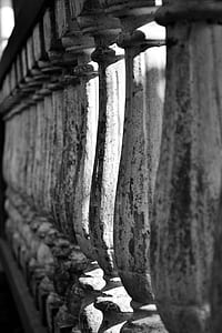 grayscale photography of concrete baluster