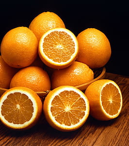 still life photo of bunch of orange fruits