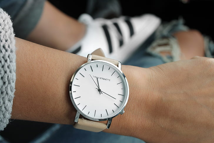 round white and silver-colored analog watch with brown leather strap