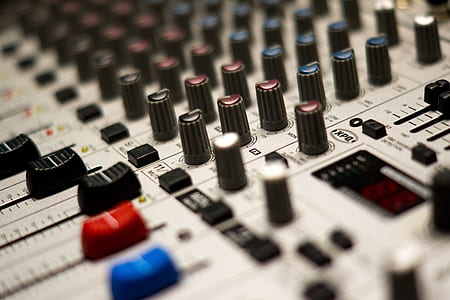 selective focus closeup photography of gray audio mixer